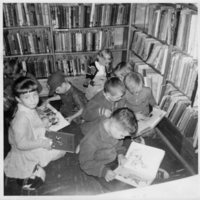 Children reading on the floor of the boys and girls area at Weston Library (1964)
