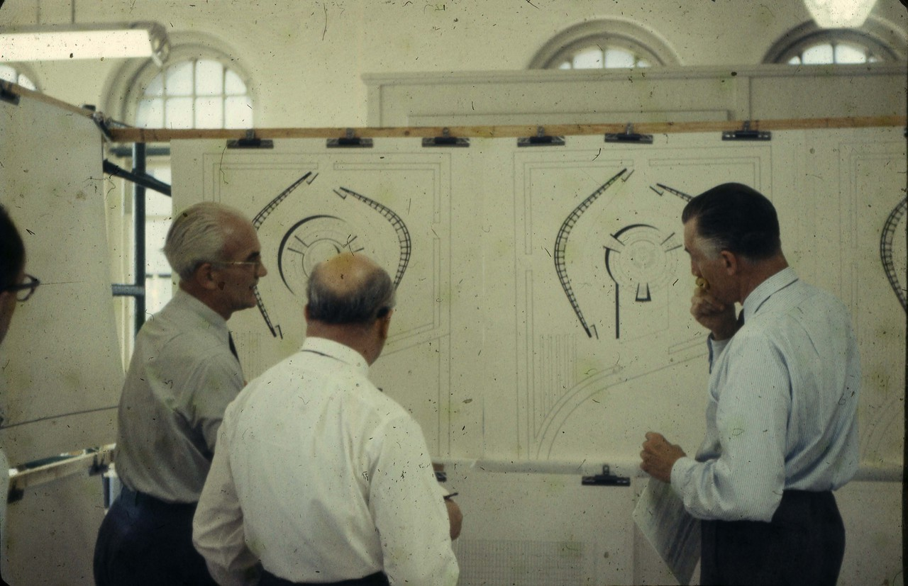 Men studying Viljo Revell drawings for City Hall