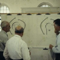 A-R4-21 - Men studying Viljo Revell drawings for City Hall.jpg